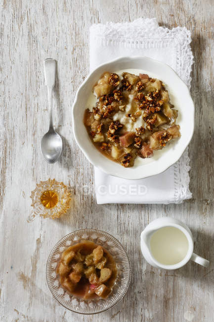 Top view of oat flakes with honey, rhubarb, nuts and milk — Stock Photo