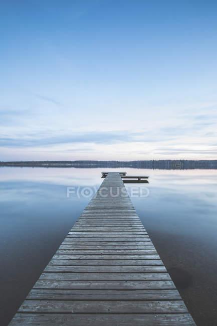 Germany, Saxony-Anhalt, jetty at Lake Bergwitz at dusk — Stock Photo