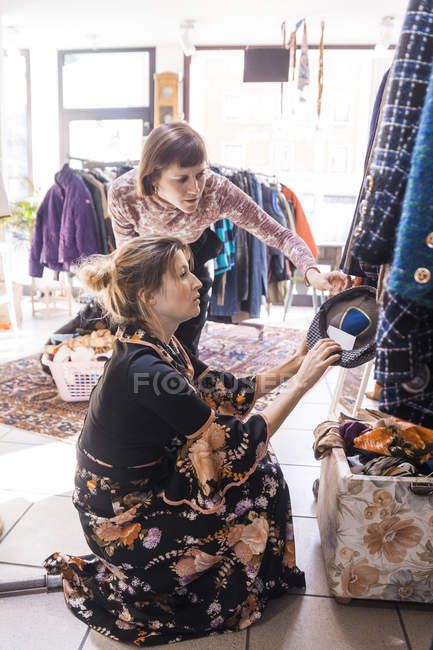 Portrait of mid adult women in second hand shop — Stock Photo
