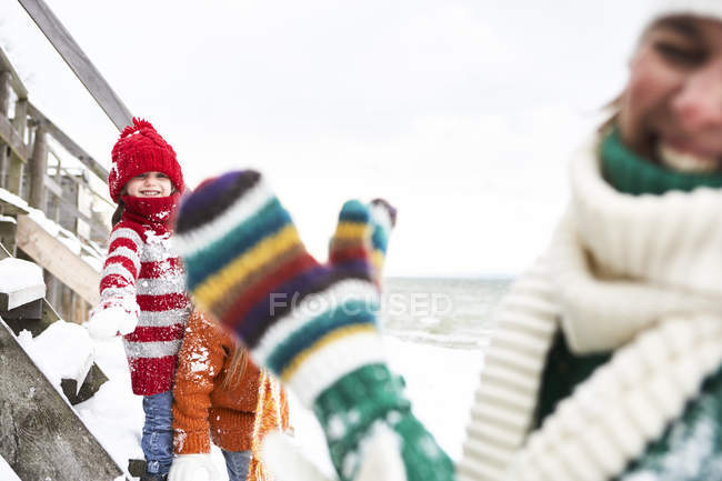 Mother and daughters having fun in winter — Stock Photo