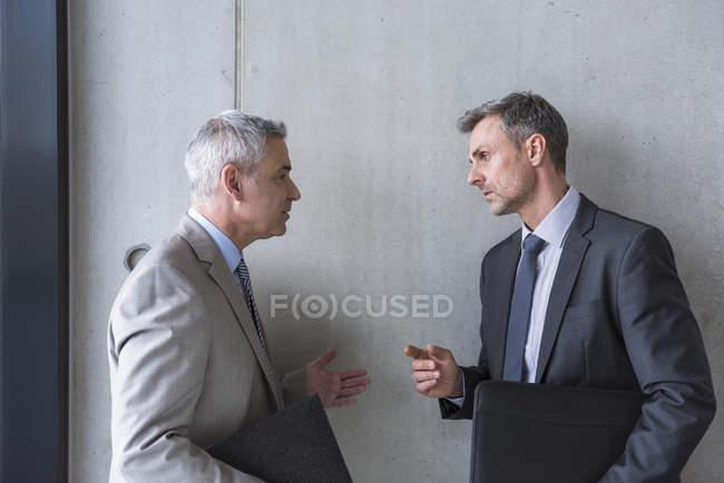 Businessmen having informal meeting — Stock Photo
