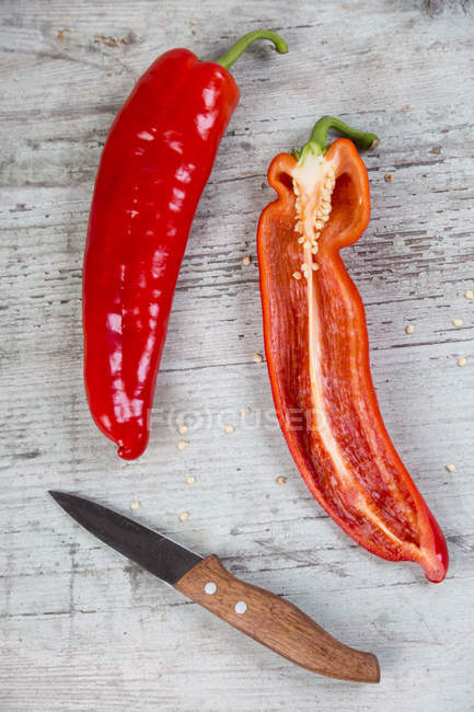 Whole and halved chili pods — Stock Photo