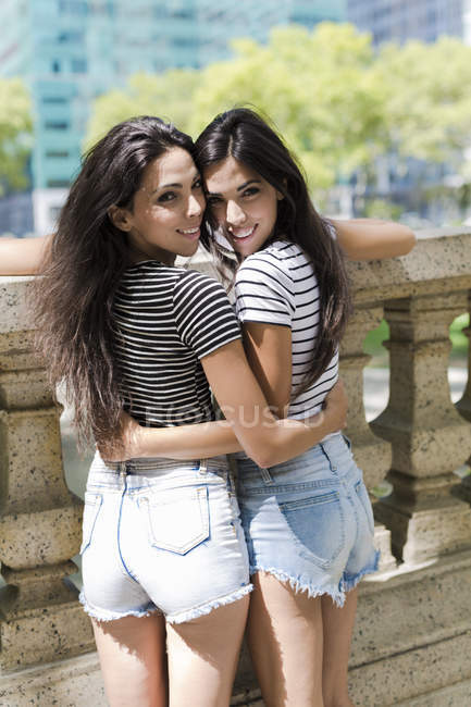 Portrait of two young women embracing — Stock Photo