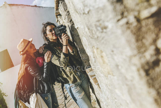 Young friends recording with old video camera — Stock Photo