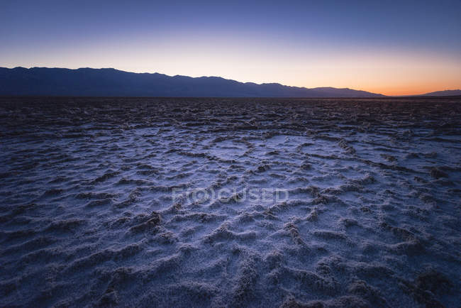 usa california death valley badwater basin at twilight mountain