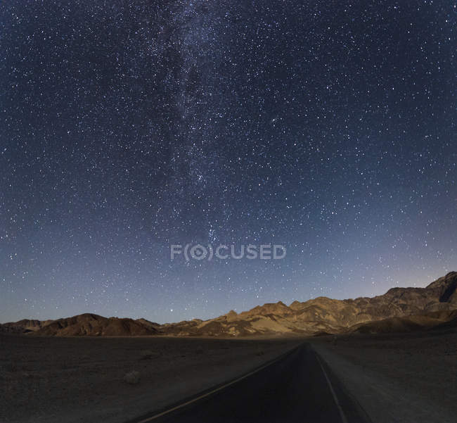 USA, California, Death Valley, stars and milky way and roadroad — Stock Photo