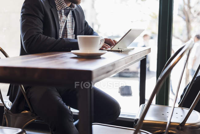 Close-up of businessman using tablet in a cafe — Stock Photo
