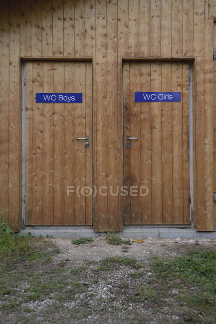 Two wooden toilet doors for boys and girls — Stock Photo