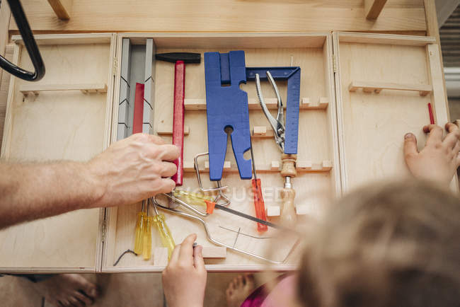 Close-up of Father and daughter working with tools — Stock Photo