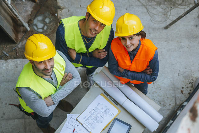 Group of workers looking at camera, viewed from above. — Stock Photo