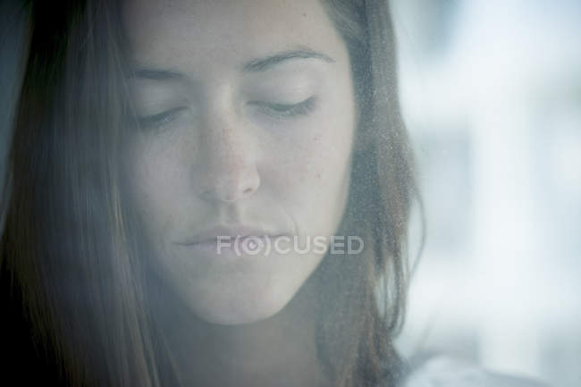 Portrait of young woman with eyes closed — Stock Photo