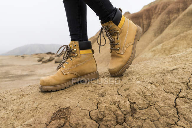 Hiking shoes of woman in nature park — Stock Photo