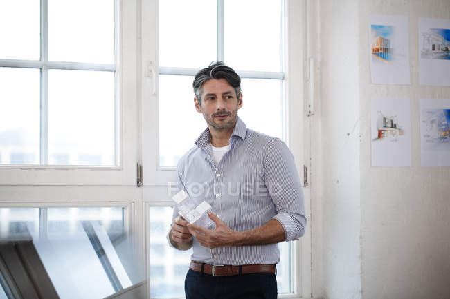 Man holding architectural model in office — Stock Photo