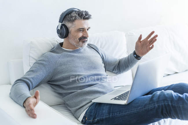 Portrait of mature man using laptop — Stock Photo