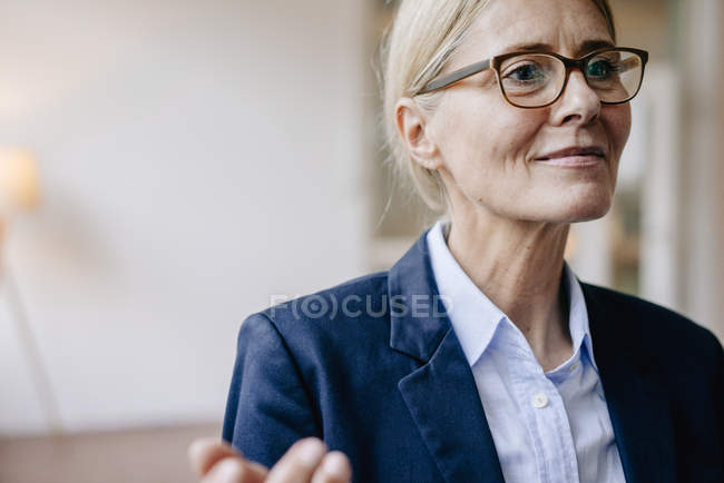 Businesswoman wearing glasses gesturing — Stock Photo