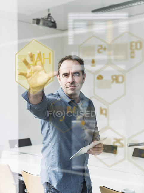 Portrait of mature businessman using digital screen — Stock Photo
