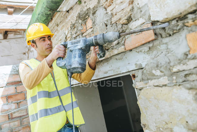 Portrait of worker with pneumatic hammer. — Stock Photo