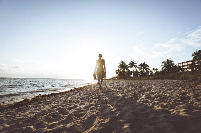 USA, Florida, Key West, woman walking on the beach at sunset — Stock Photo