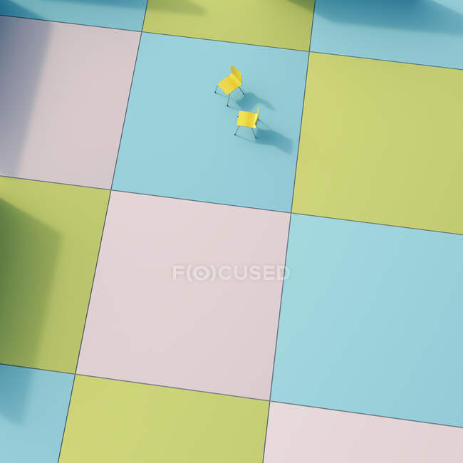 Two yellow chairs on coloured tiles, 3D Rendering — copy