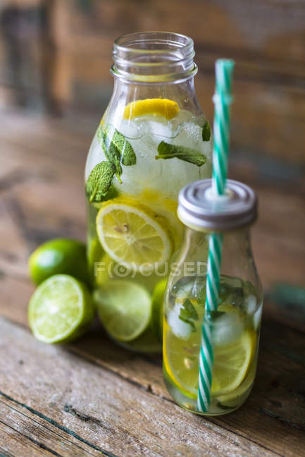 Closeup view of two bottles with fruity water — Stock Photo