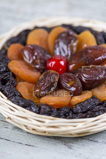 Various dried fruits in basket — Stock Photo