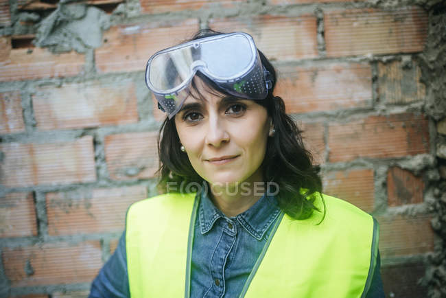 Portrait of working woman with safety glasses — Stock Photo