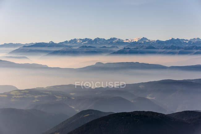 Italy, South Tyrol, mountain range in fog — Stock Photo