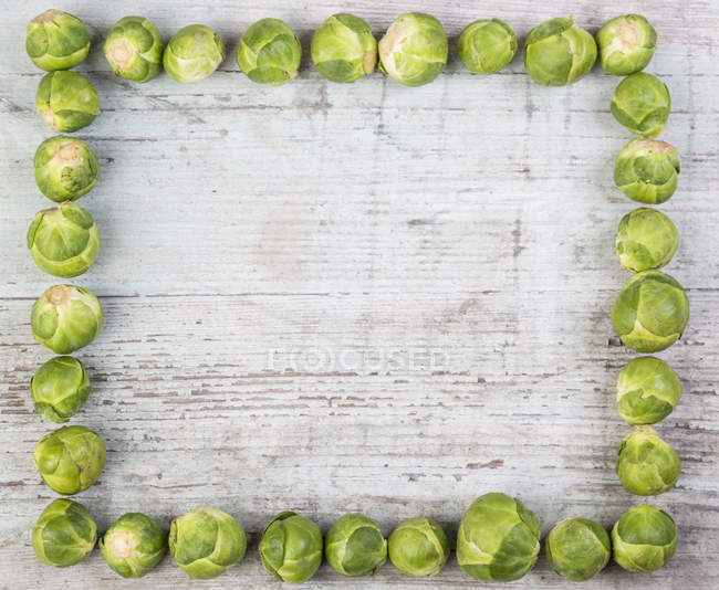 Frame with fresh Brussels sprouts — Stock Photo