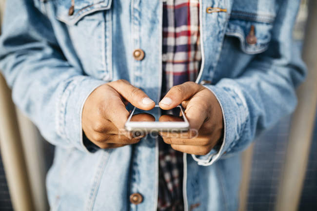 Close up of  Hands of man using mobile. — Stock Photo