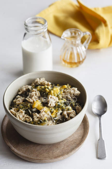 Closeup view of oat flakes with milk and passion fruit — Stock Photo