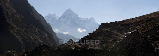 View of rocks and mountain on foreground during daytime — Stock Photo