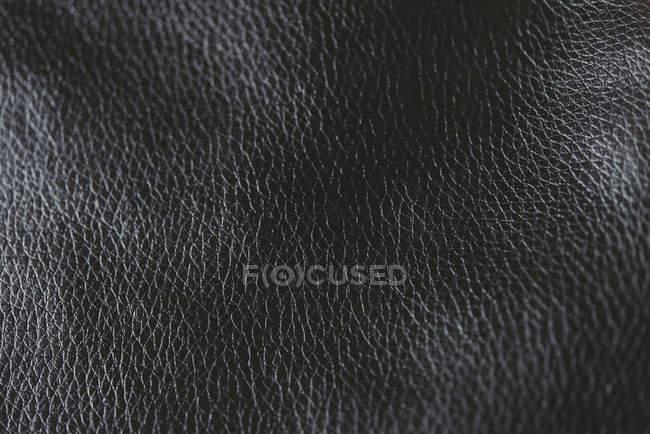 Vista dall'alto della texture in pelle fantasia nera — Foto stock