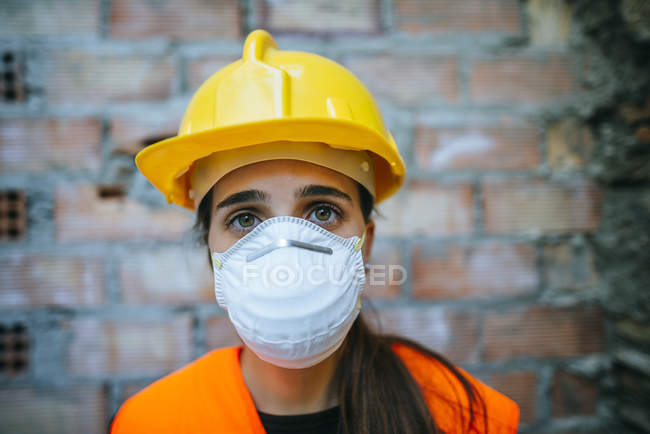 Portrait of working woman with safety mask. — Stock Photo