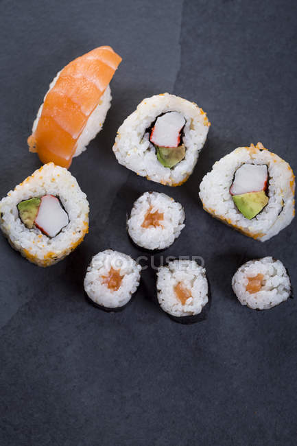 Top view of sushi set on dark background — Stock Photo