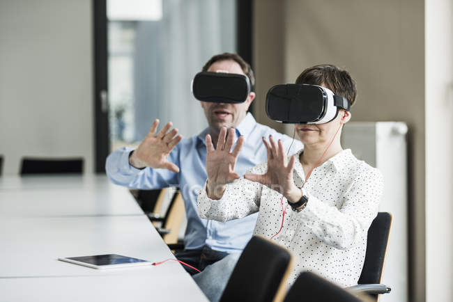 Portrait of mature business colleagues using virtual reality glasses — Stock Photo