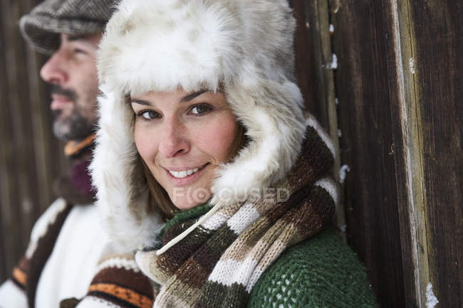 Portrait of smiling woman wearing fur cap in winter — Stock Photo