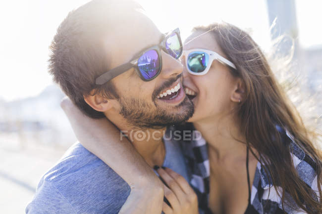 Cropped portrait of young smiling couple — Stock Photo