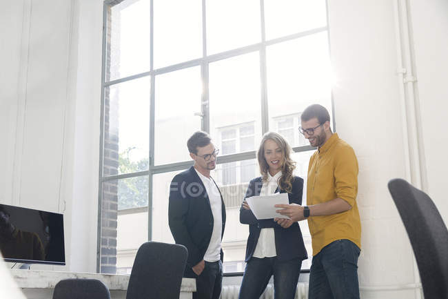 Young colleagues having a meeting in office — Stock Photo