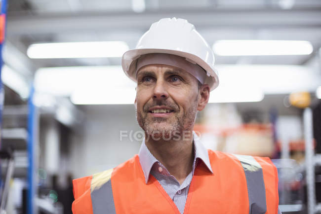 Man standing in factory hall — Stock Photo