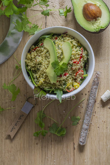 Top view of couscous salad with avocado and spinach — Stock Photo