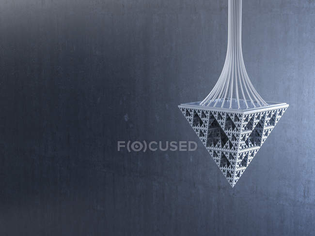 Pendulum made of triangles on gray background — Stock Photo