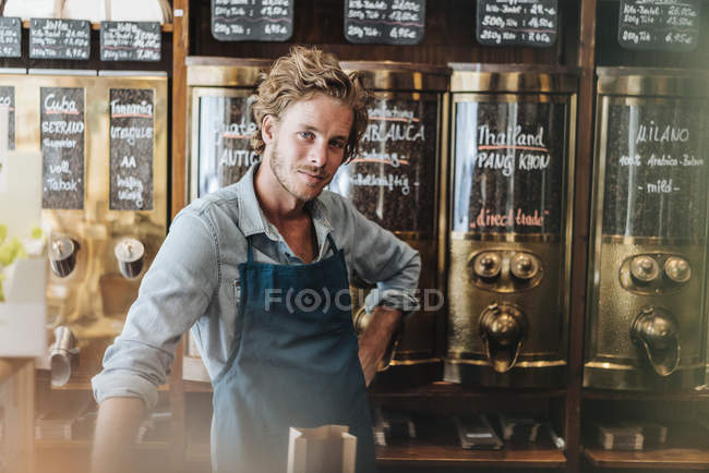 Portrait of confident coffee roaster smiling in shop — Stock Photo