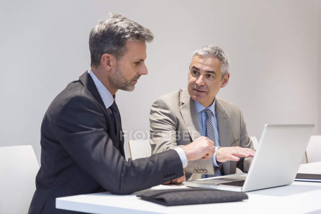 Businessmen working with laptop — Stock Photo