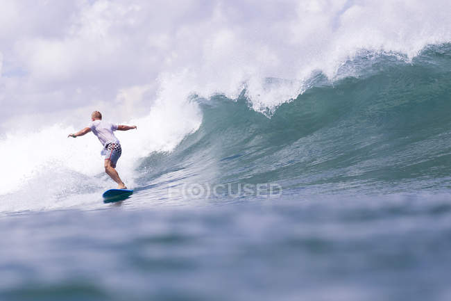 Indonesia, Bali, man surfing on a wave in ocean — Stock Photo