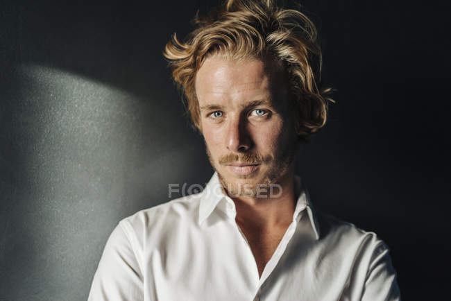 Portrait of confident blond businessman wearing white shirt looking at camera — Stock Photo