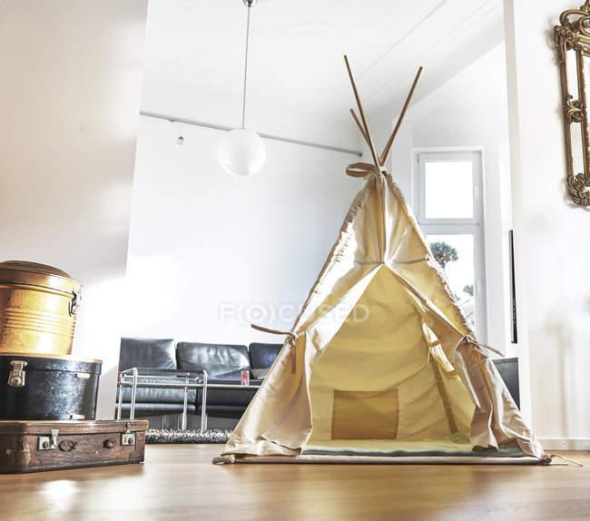 Teepee on floor in modern living room — Stock Photo
