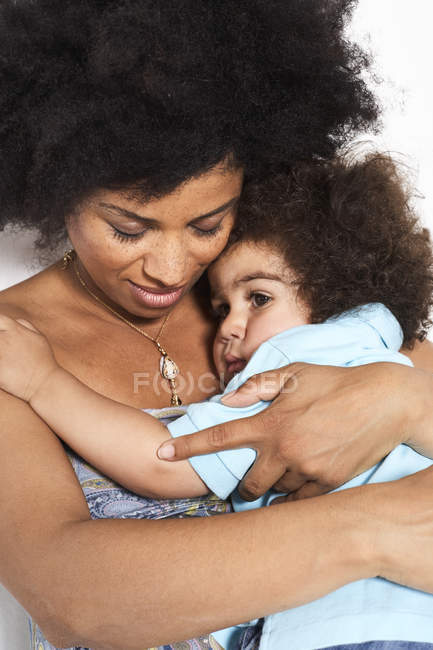 African american mother and little son cuddling — Stock Photo