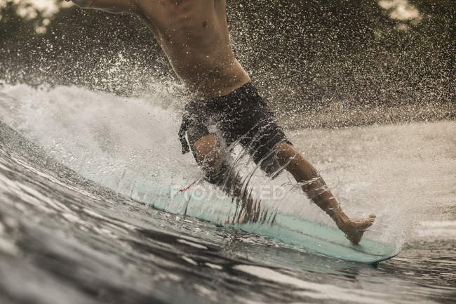 Close-up of man surfing in ocean — Stock Photo