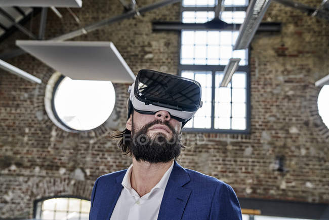 Businessman wearing VR glasses — Stock Photo
