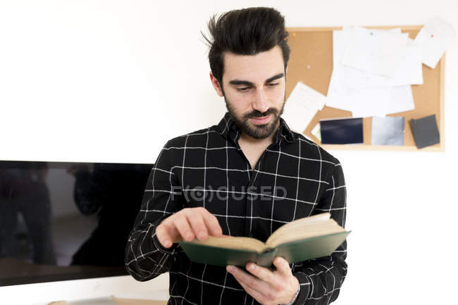 Man leafing book — Stock Photo